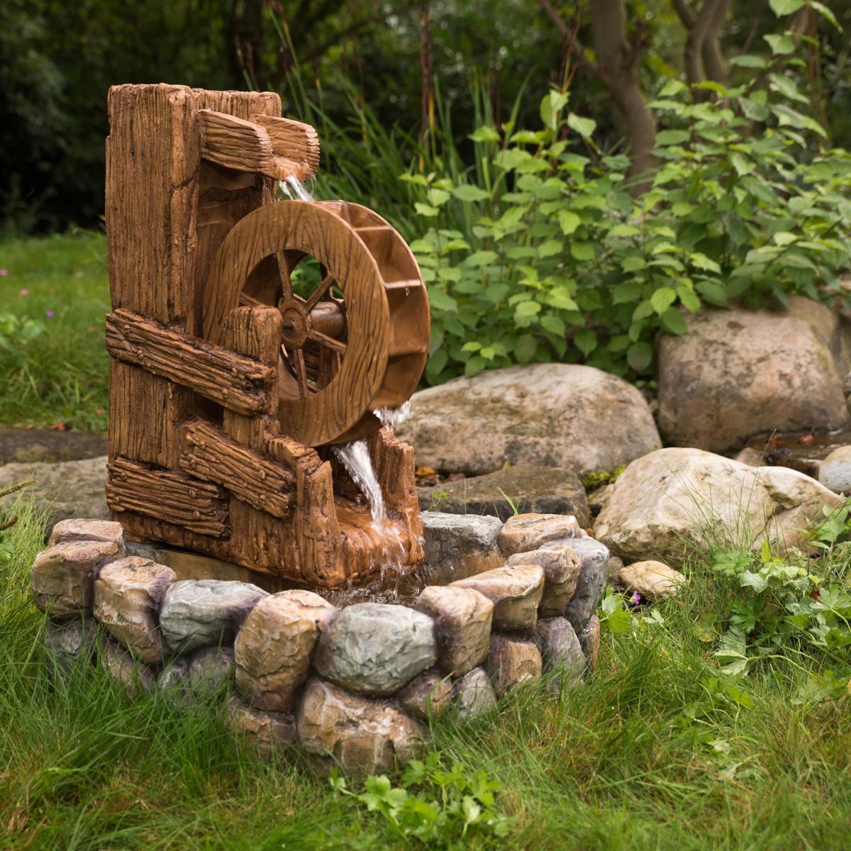 Photo Fontaine De Jardin fontaine de jardin avec roue à aubes